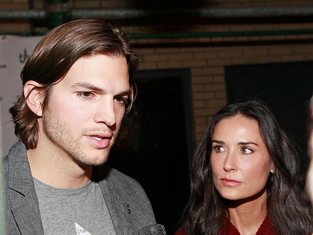 Ashton Kutcher talking and Demi Moore looking at Kutcher