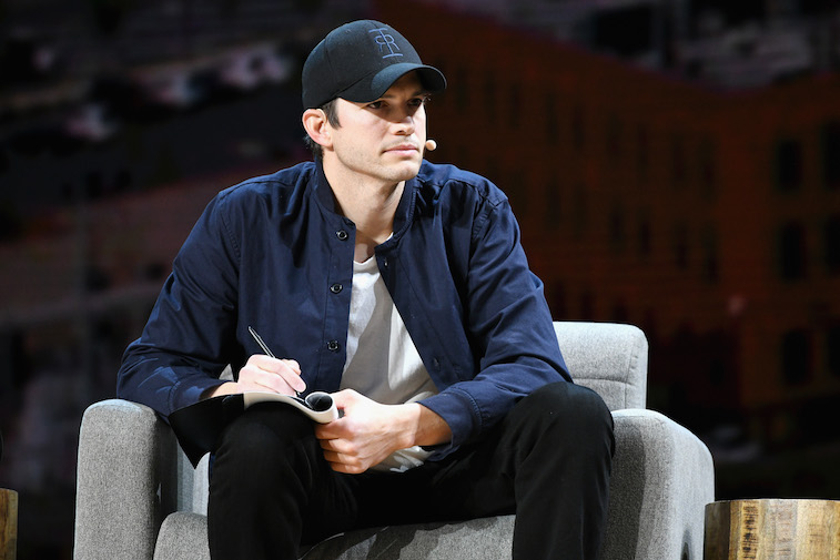 Ashton Kutcher speaks onstage