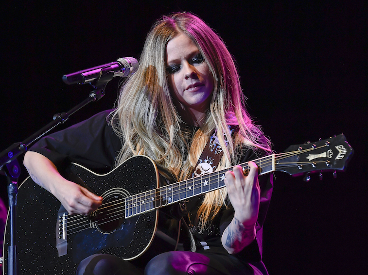 Avril Lavigne performs onstage