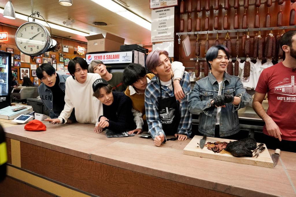 Jungkook, Jin, SUGA, J-Hope, V, RM, and Jimin of BTS inside Katz's Deli