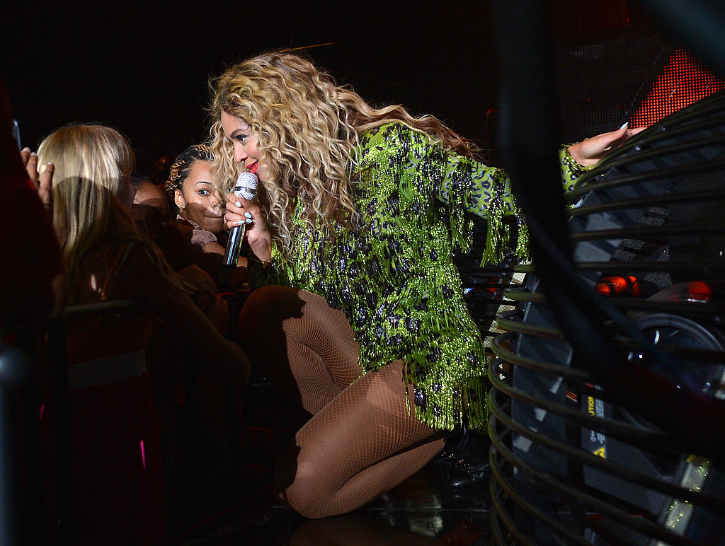Beyoncé in a glittery green leopard print dress