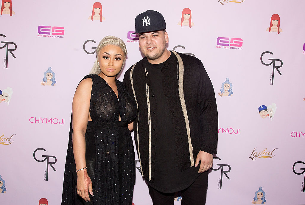 Blac Chyna and Rob Kardashian in front of a repeating background