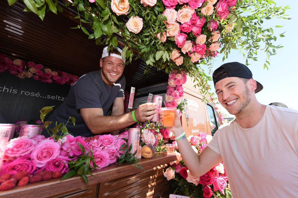 Colton Underwood with Blake Horstmann enjoy a Smirnoff Seltzer's Raspberry Rosè at Fizz Fight Festival