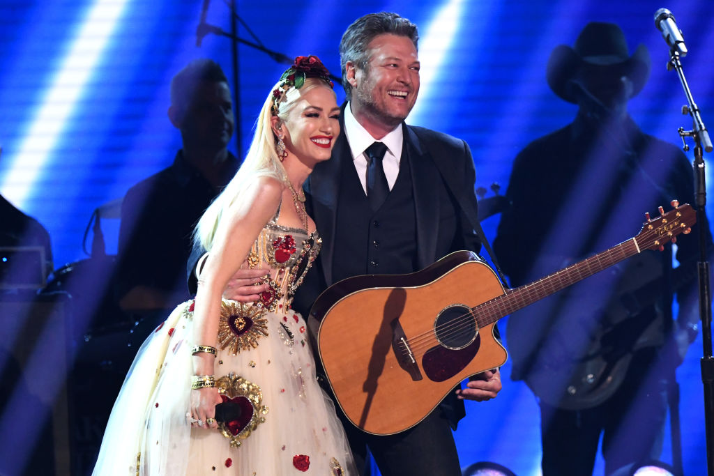 Gwen Stefani (L) and Blake Shelton onstage during the 62nd Annual GRAMMY Awards