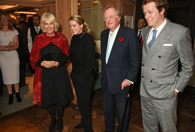 Camilla Parker Bowles, Laura Lopes, and Andrew Parker Bowles pose with Tom Parker Bowles at the launch of his book, 'Fortnum and Mason: The Cook Book' on Oct. 18, 2016
