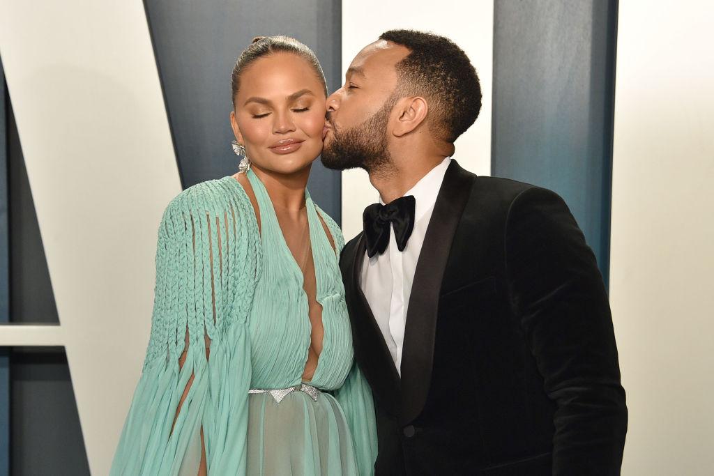 Chrissy Teigen and John Legend embracing