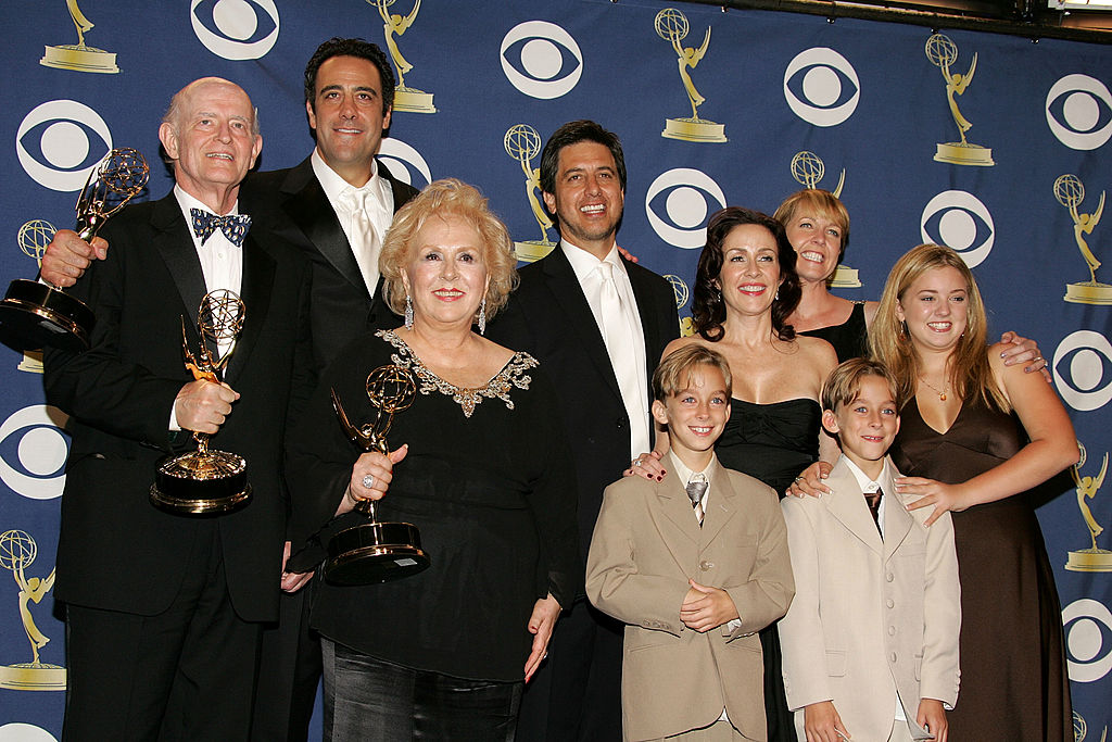 The cast of 'Everybody Loves Raymond', (L-R) Peter Boyle, Brad Garrett, Doris Roberts, Ray Romano, Patricia Heaton, Monica Horan, Sawyer Sweeten, Sullivan Sweeten and Madylin Sweeten pose with the Emmy for Outstanding Comedy Series in the press room at the 57th Annual Emmy Awards