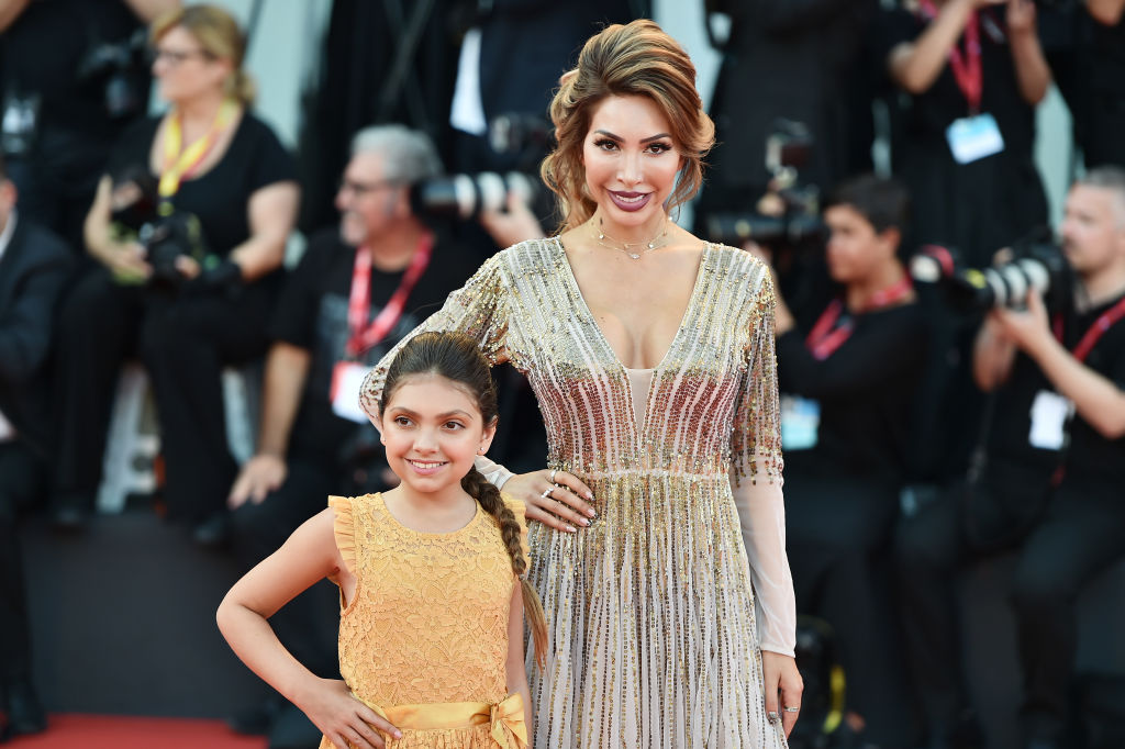 Farrah Abraham and Sophia Laurent Abraham walk the red carpet