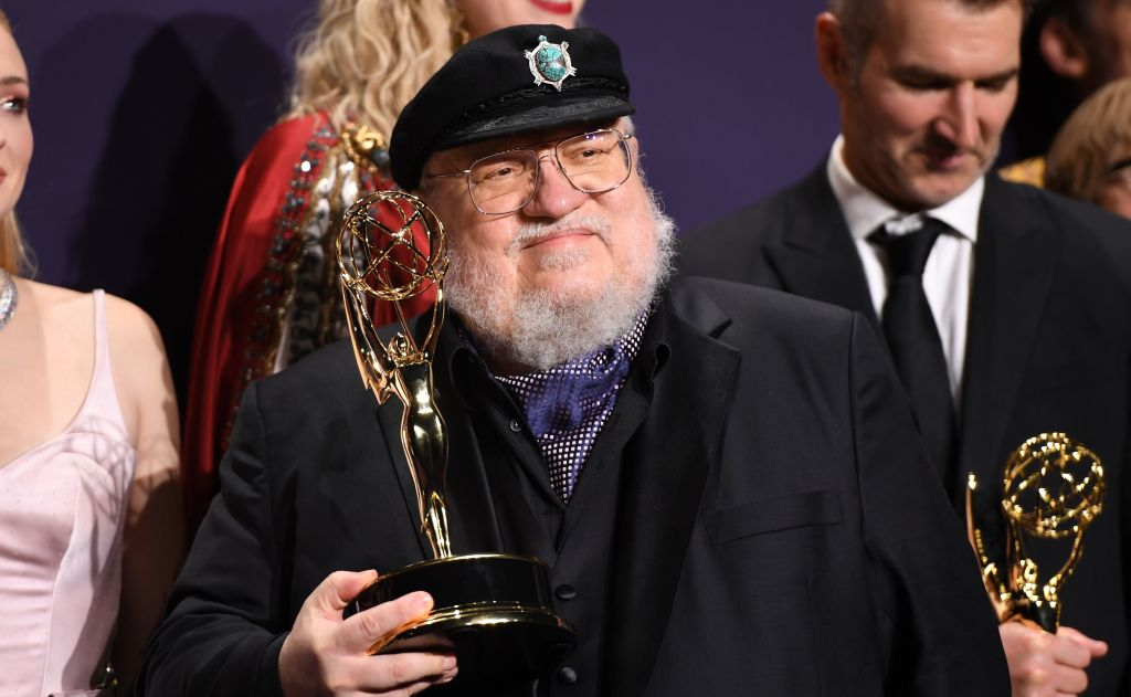 """George R. R. Martin poses with the Emmy for Outstanding Drama Series """"Game Of Thrones"""""""