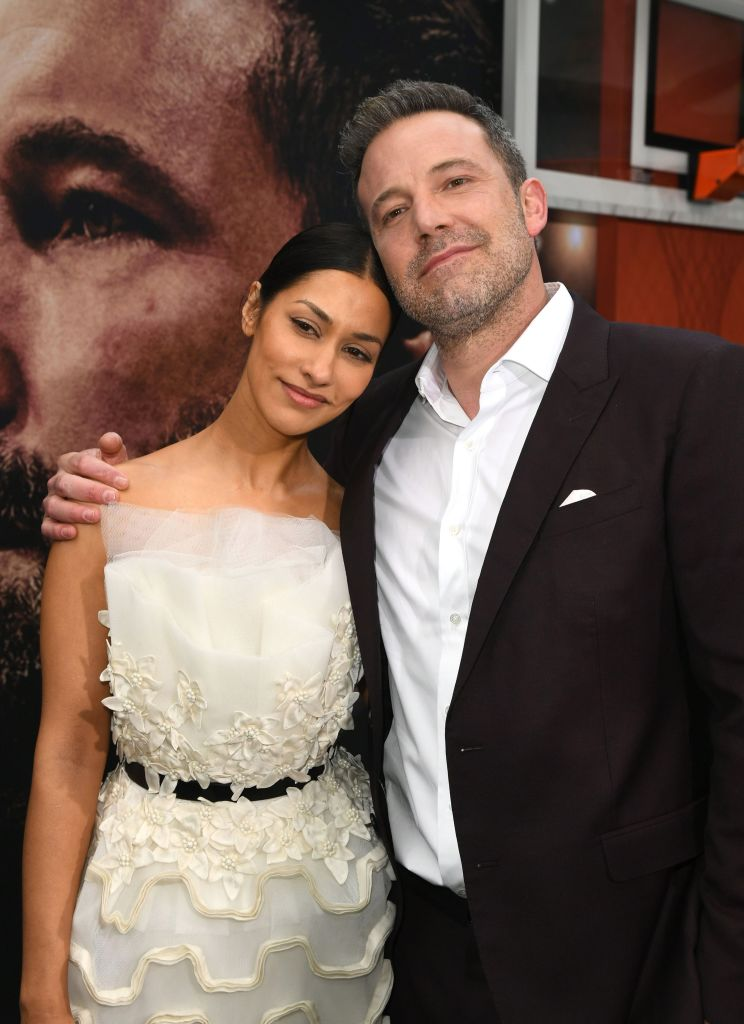 "Janina Gavankar and Ben Affleck attend the premiere of Warner Bros Pictures' "" The Way Back"""