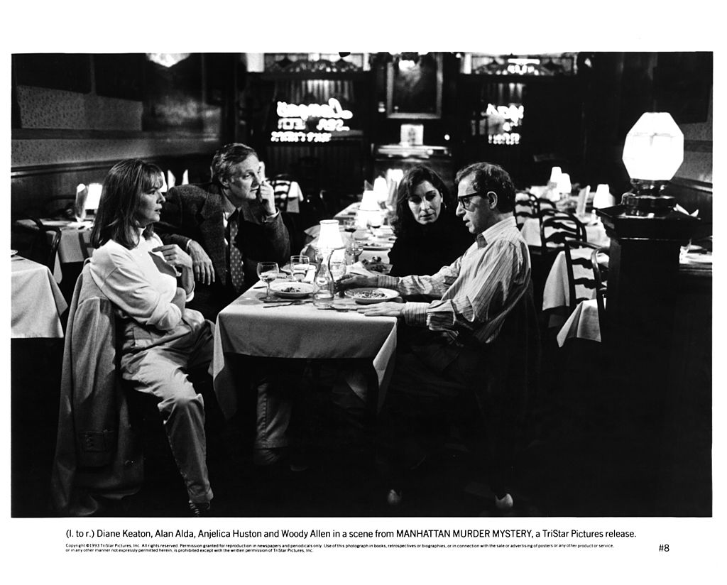 Diane Keaton, Alan Alda, Anjelica Huston and Woody Allen in a scene from 'Manhattan Murder Mystery'