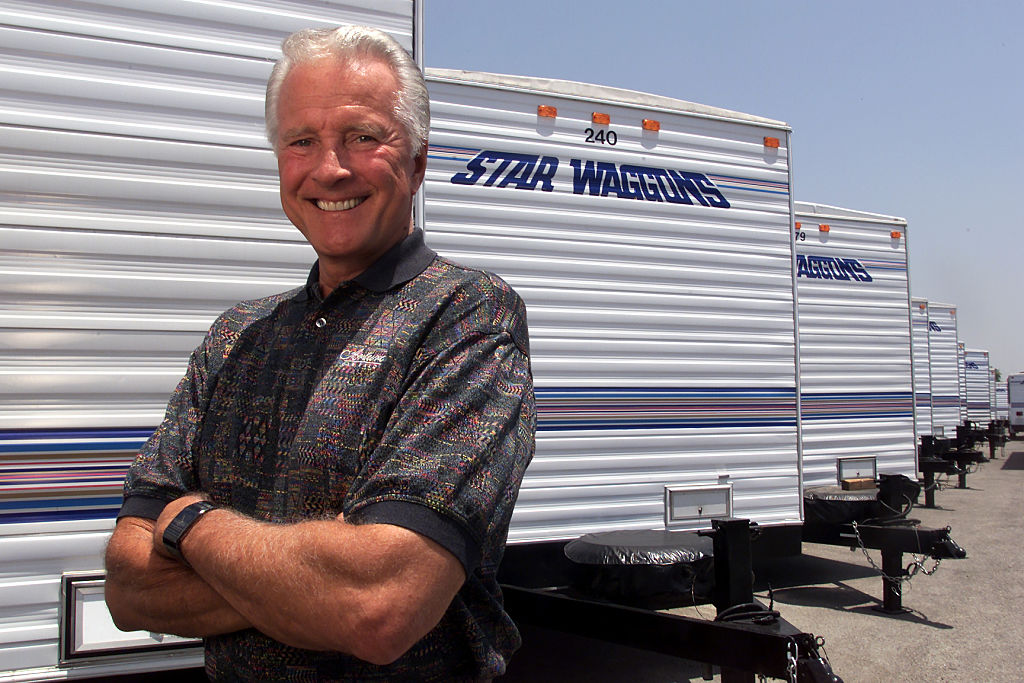 Lyle Waggoner standing with one of his Star Waggons