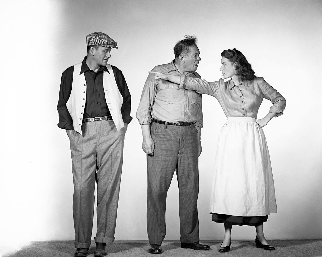 From left to right, actors John Wayne (1907 - 1979) as Sean Thornton, Victor McLaglen (1886 - 1959) as Squire 'Red' Will Danaher and Maureen O'Hara (1920 - 2015) as Mary Kate Danaher in a publicity still for the film 'The Quiet Man', 1952