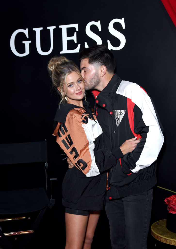 Hannah Godwin and Dylan Barbour | Presley Ann/Getty Images for GUESS?, Inc.
