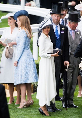 Prince Harry and Meghan Markle face away from Princess Beatrice and Princess Eugenie