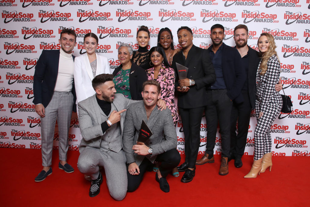 Hollyoaks cast in front of a repeating background