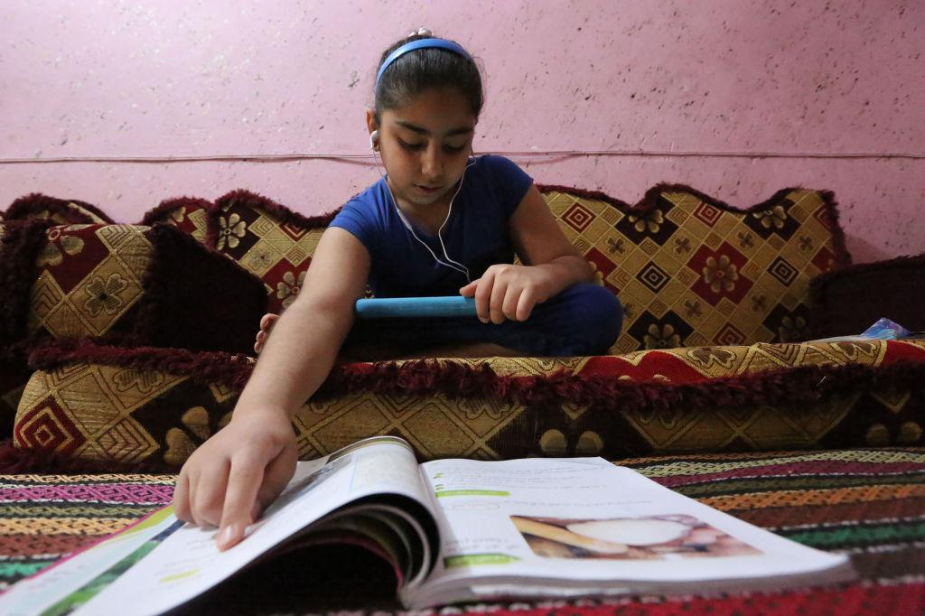 Iraqi schoolgirl studying remotely