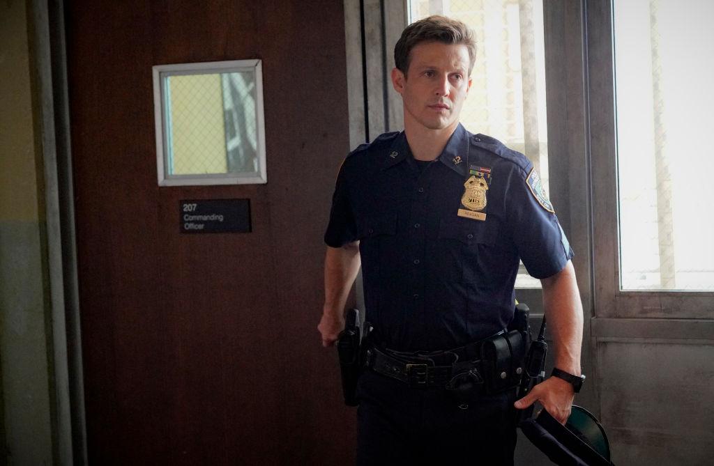 Will Estes as Jamie Reagan in police uniform