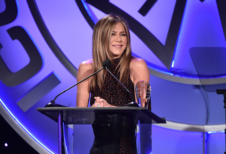 Jennifer Aniston speaks onstage
