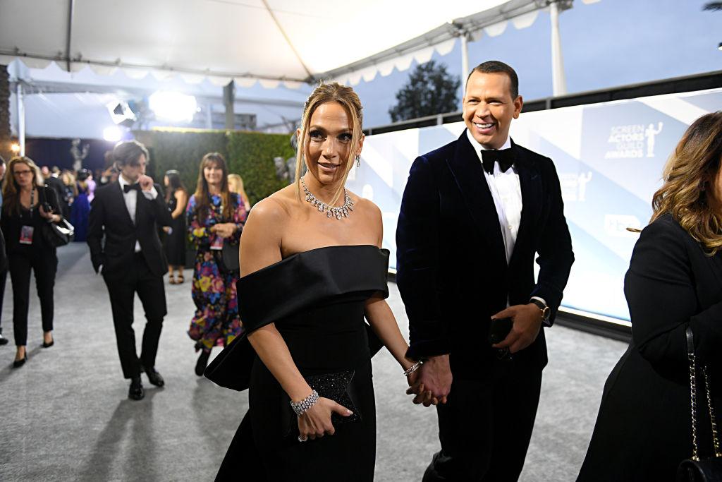 Jennifer Lopez and Alex Rodriguez holding hands