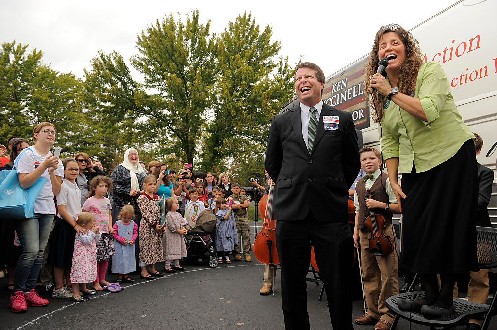 Jim Bob Duggar, center, and his wife, Michelle Duggar, make a stop on their 'Values Bus Tour'