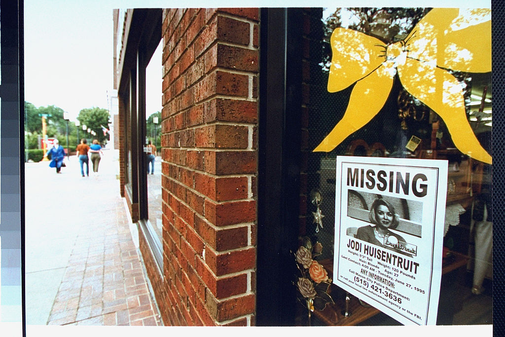 Storefront window with Jodi Huisentruit missing poster
