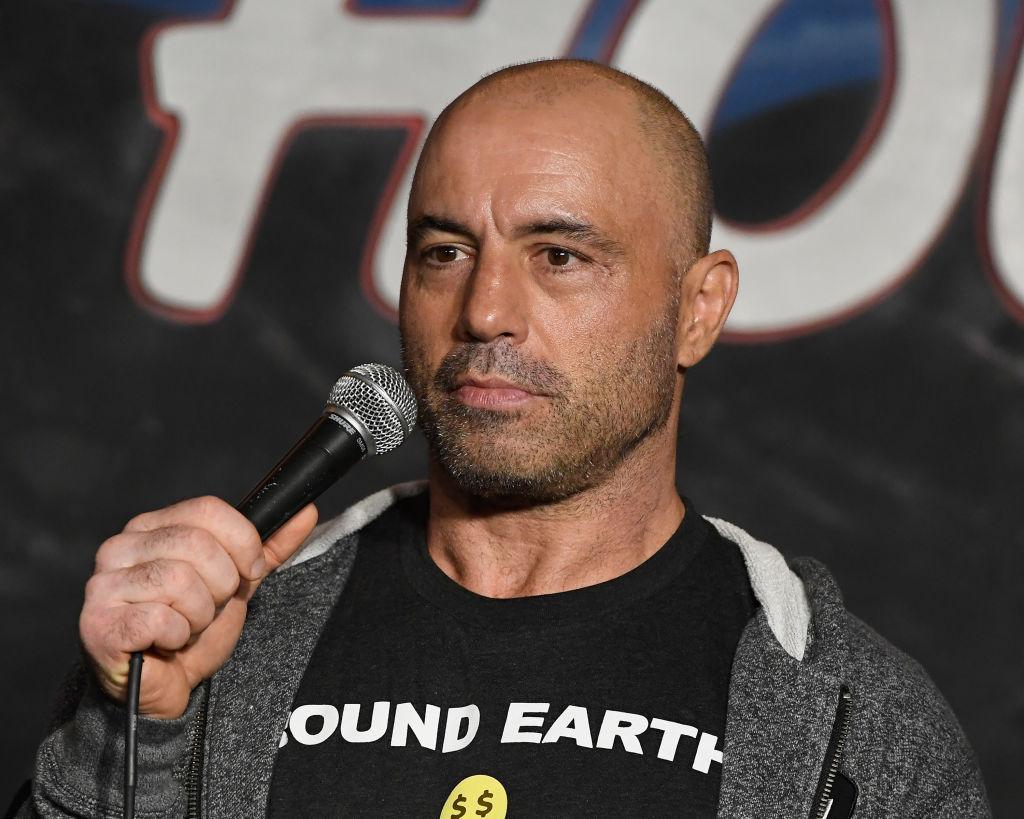 Joe Rogan holding a microphone