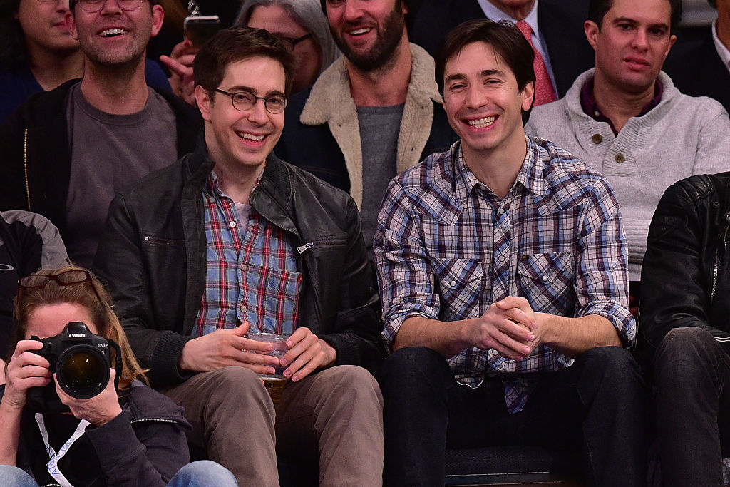 Christian and Justin Long in plaid, laughing