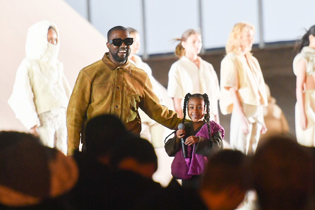Kanye West and North West at a fashion show in March 2020