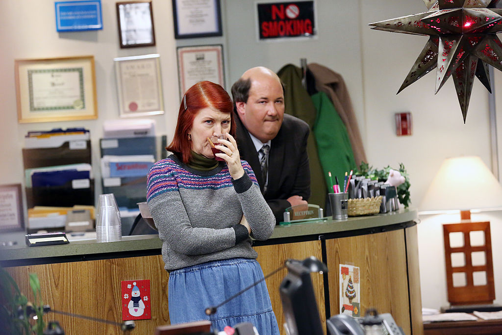 Kate Flannery and Brian Baumgartner as The Office characters