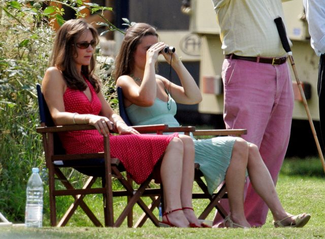 Kate Middleton and Pippa Middleton watch Prince William play in a charity polo match on June 17, 2006
