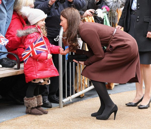Kate Middleton meets a young girl in Liverpool, England, on Feb. 14, 2012