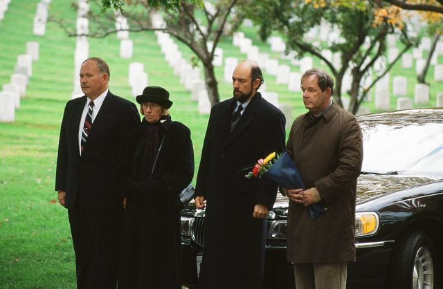 "Kathryn Joosten as Dolores Landingham, Richard Schiff as Toby Ziegler, and Paul Austin as George Huffnagle in 'The West Wing' Season 1 Episode 10: ""In Excelsis Deo."""