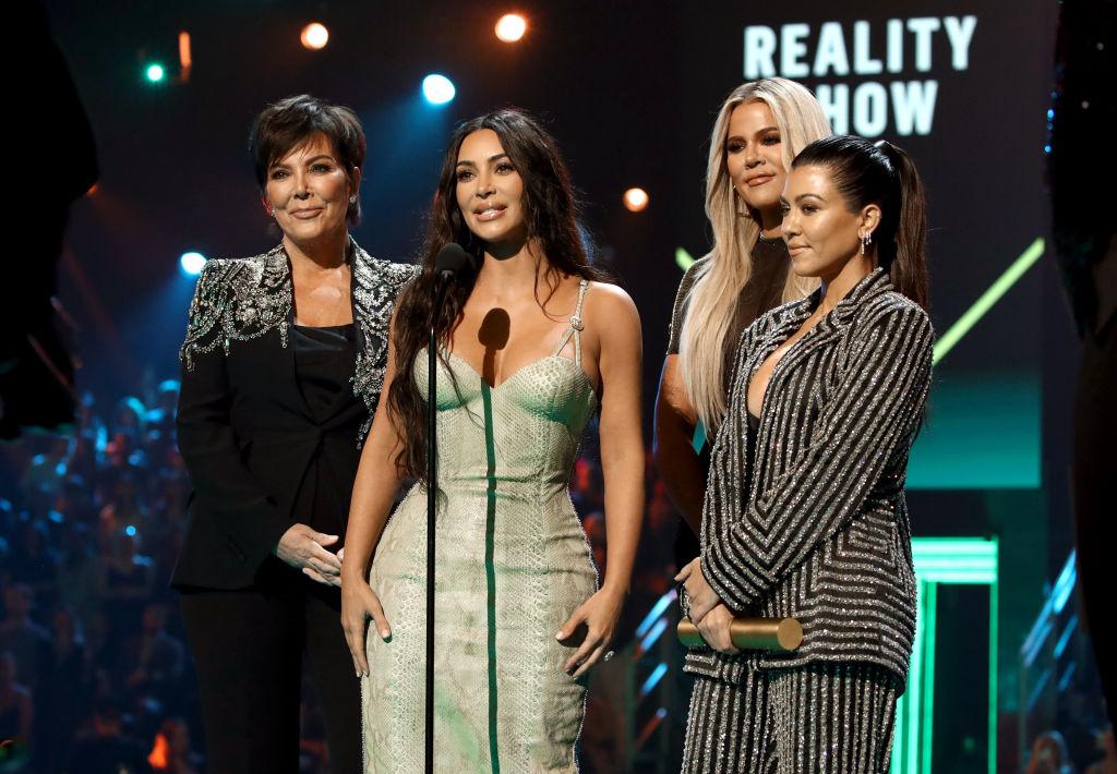 Kris Jenner, Kim Kardashian, Khloé Kardashian, and Kourtney Kardashian accept The Reality Show of 2019 for 'Keeping Up with the Kardashians' on stage during the 2019 E! People's Choice Awards