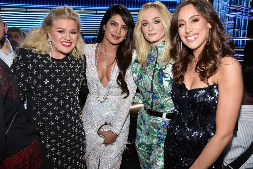 Kelly Clarkson, Priyanka Chopra, Sophie Turner, and Danielle Jonas attend the 2019 Billboard Music Awards