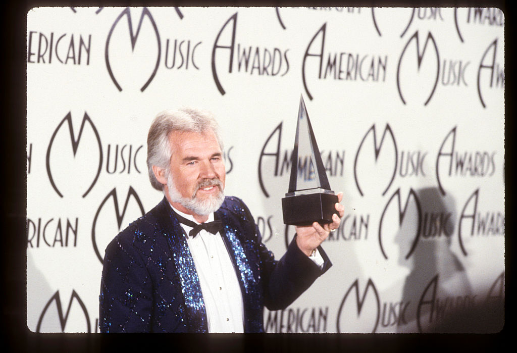 Kenny Rogers in 1985 at the American Music Awards | Walt Disney Television via Getty Images Photo Archives/Walt Disney Television via Getty Images