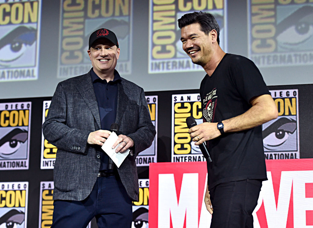 Kevin Feige and Destin Daniel smiling on stage