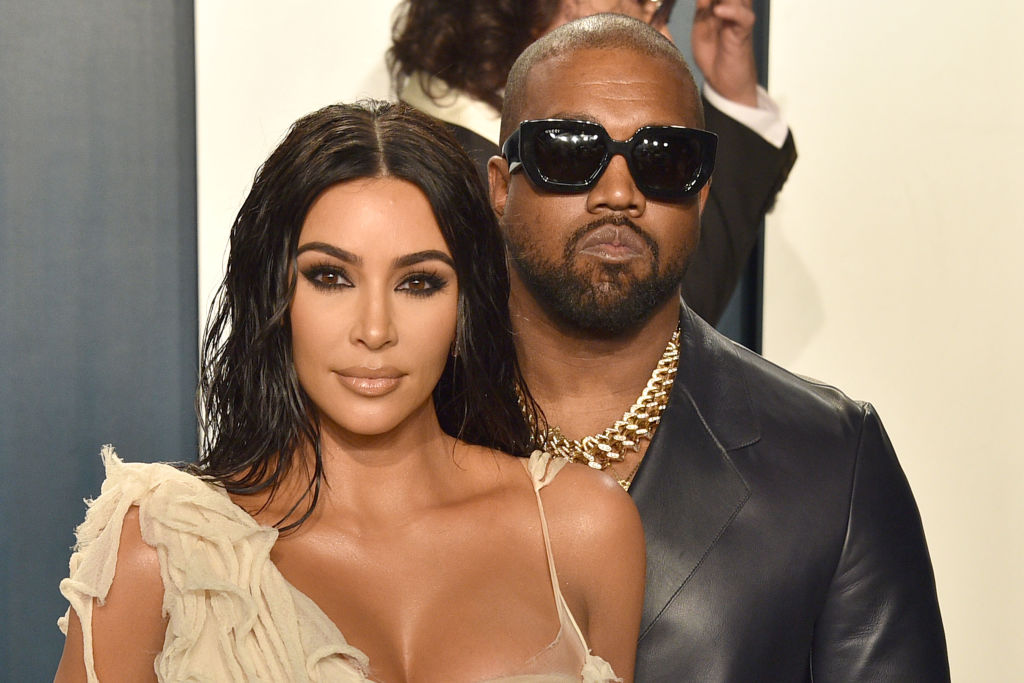 Kim Kardashian West and Kany West in front of a repeating background