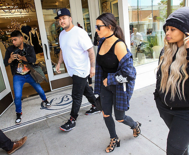 Kim Kardashian walks with Rob Kardashian and Blac Chyna in 2016