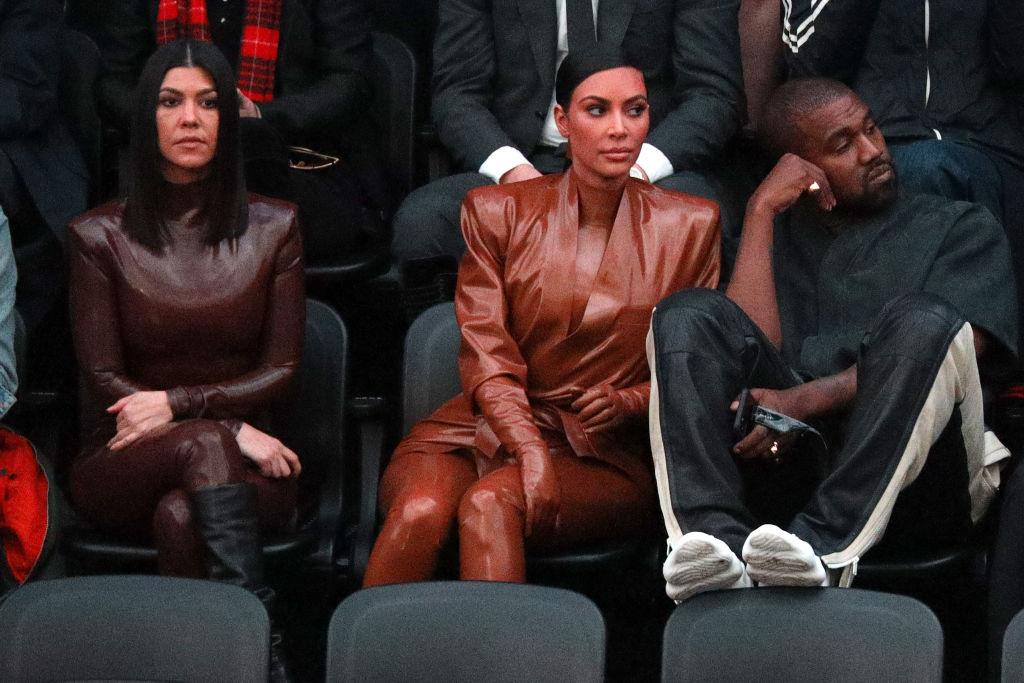 Kourtney Kardashian, Kim Kardashian West, and Kanye West attend the Balenciaga show as part of the Paris Fashion Week