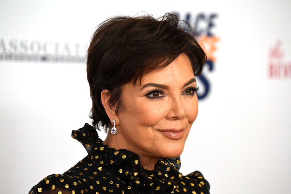 Kris Jenner smiling looking off camera
