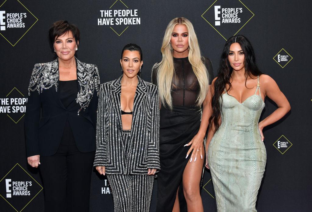 Kris Jenner, Kourtney Kardashian, Khloé Kardashian, and Kim Kardashian West on the red carpet at an award show in November 2019