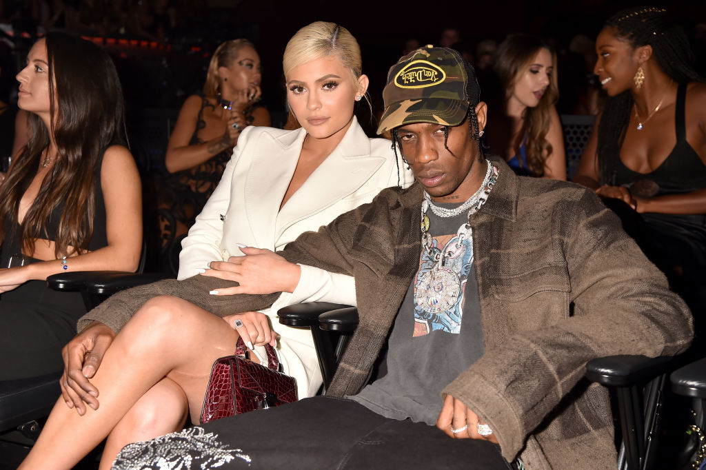 Kylie Jenner and Travis Scott sitting together