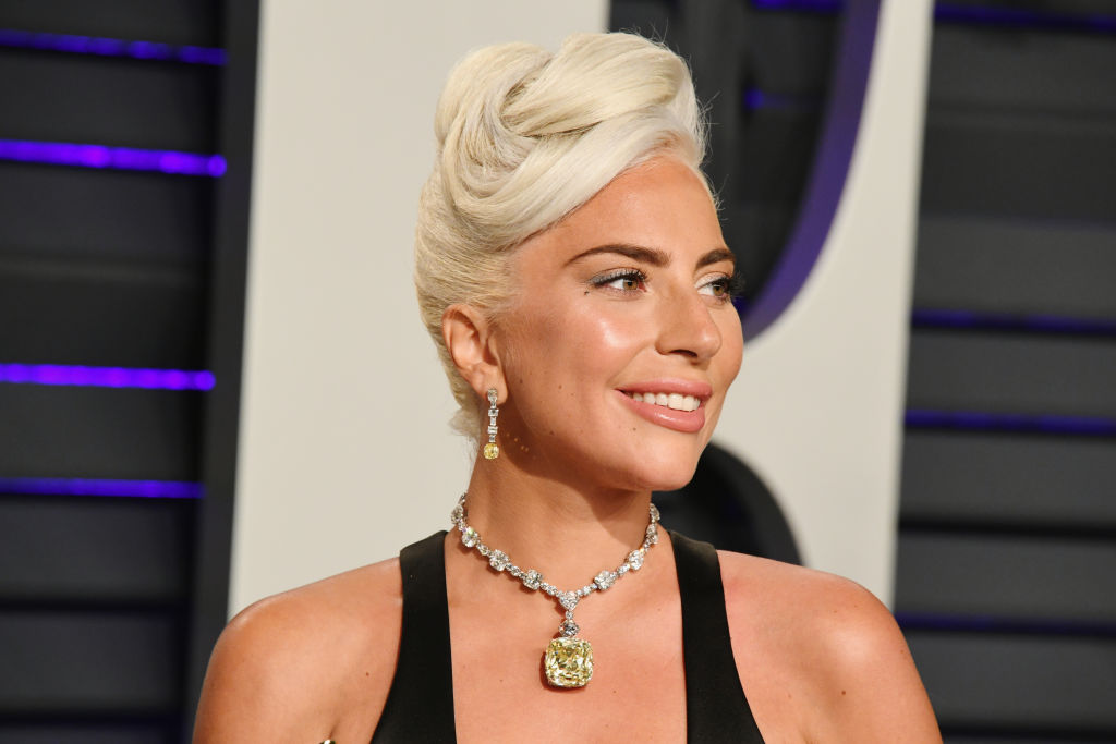 Lady Gaga smiling slightly turned away from the camera