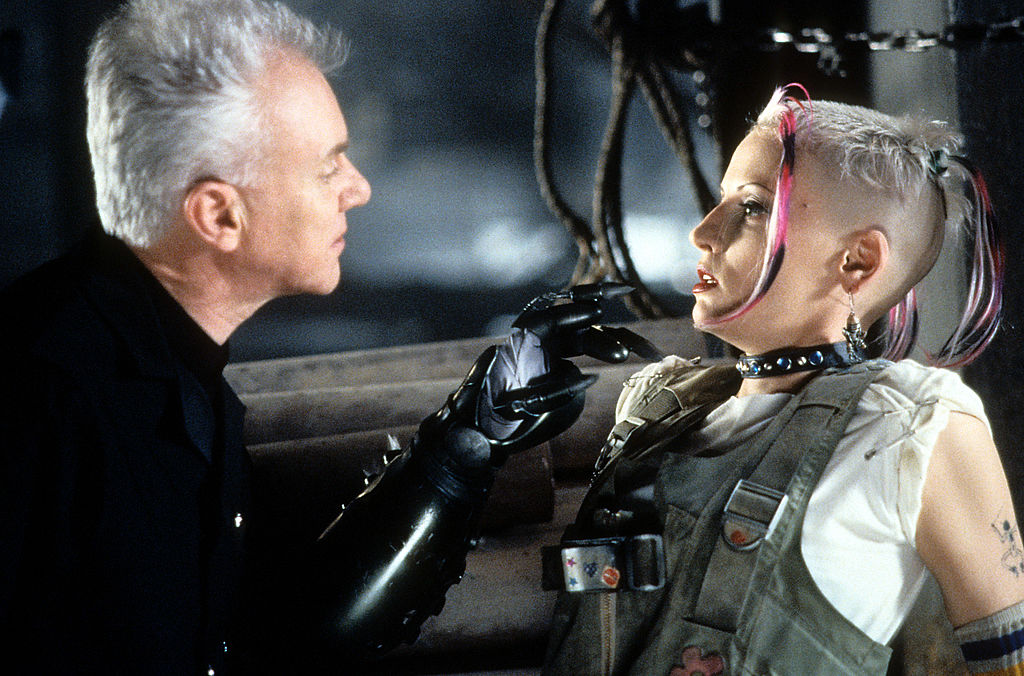 Lori Petty and Malcolm McDowell