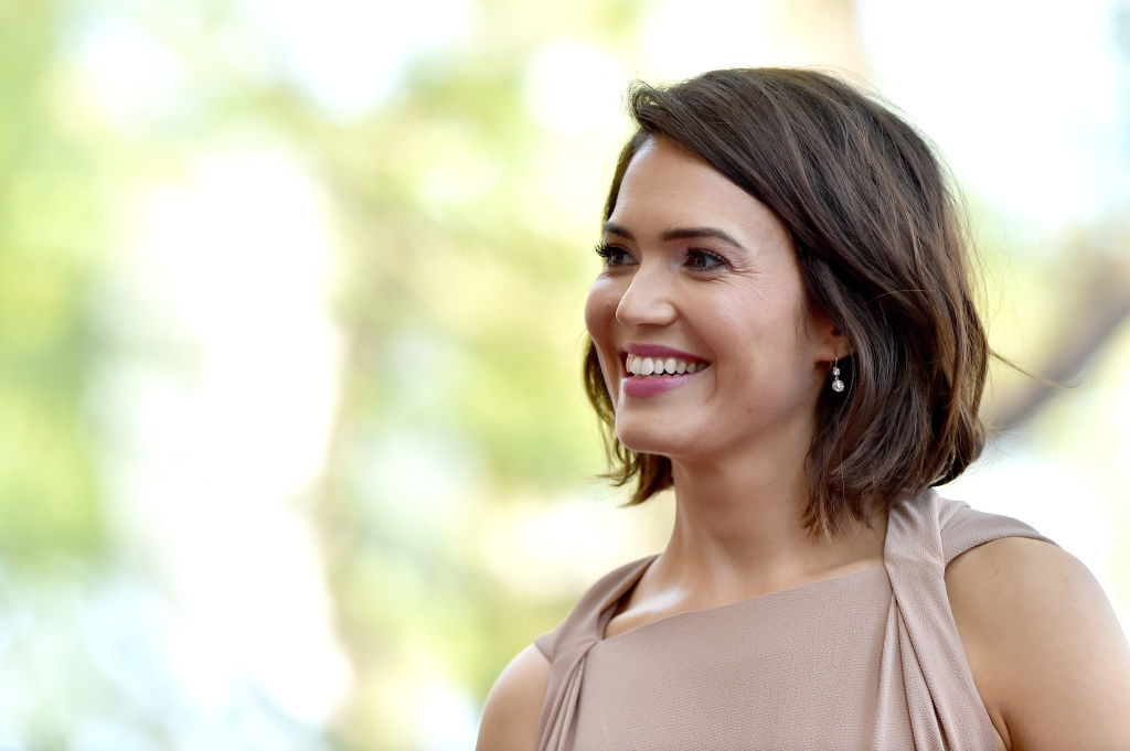 Mandy Moore smiling, turned slightly off camera