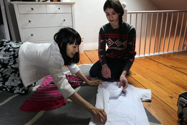 Marie Kondo gives Otti Logan a folding lesson on Feb. 5, 2015