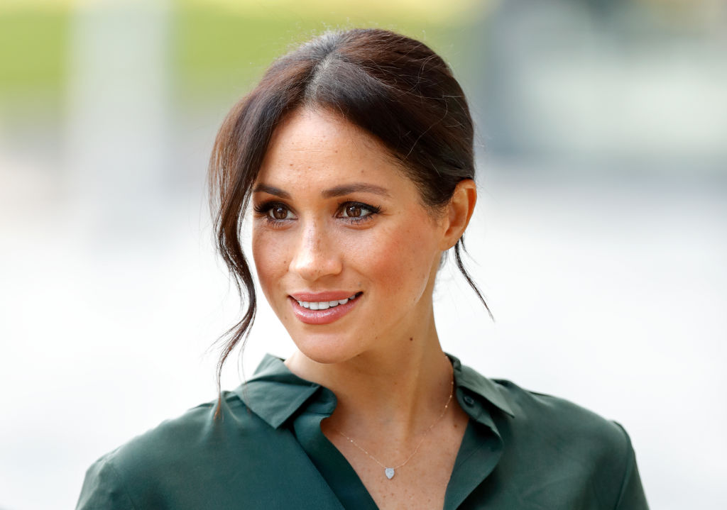 Meghan Markle smiling, looking off camera