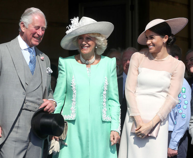 Prince Charles, Camilla Parker Bowles, and Meghan Markle share a laugh