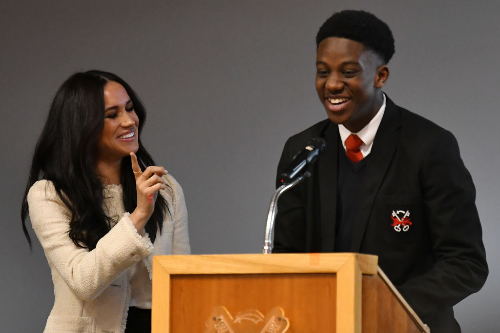 Meghan Markle and student Aker Okoye speaks during a special school assembly at the Robert Clack Upper School in Dagenham ahead of International Women's Day